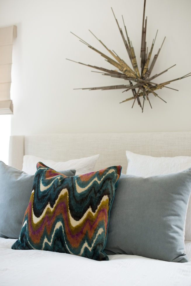 Colorful Throw Pillow and Brass Wall Sculpture