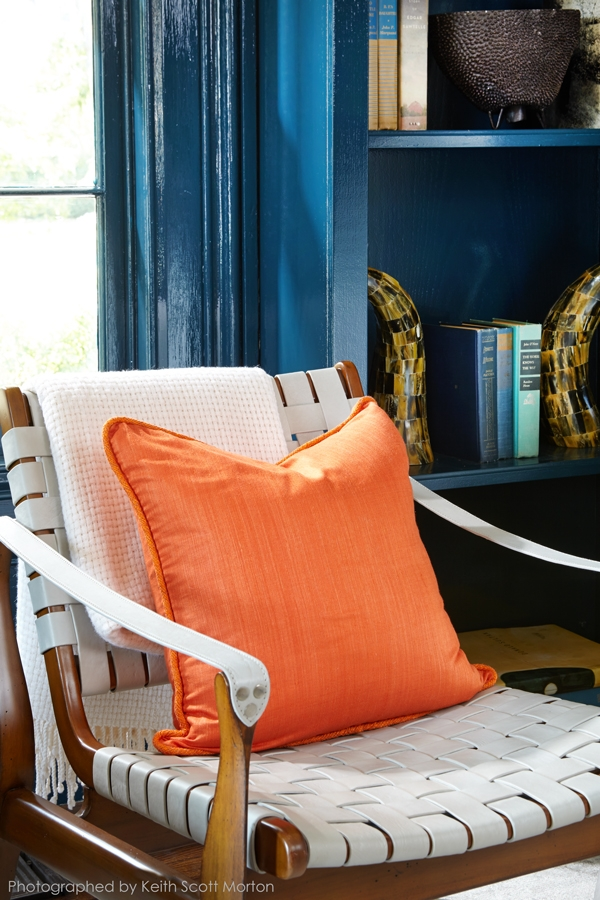 Orange Pillow On Modern Woven Leather Chair