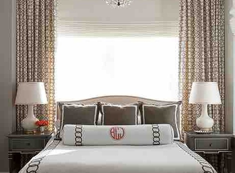 Gray and brass accented bedroom by Jenny Wolf